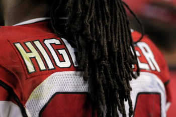 DENVER - SEPTEMBER 03:  The hair of running back Tim Hightower #34 of the Arizona Cardinals obscures the name on his jersey as he awaits action on the sidelines against the Denver Broncos during NFL preseason action at Invesco Field at Mile High on Septem