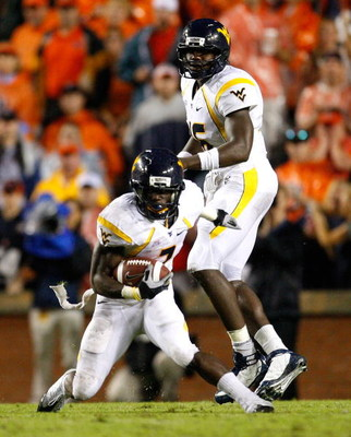 AUBURN, AL - SEPTEMBER 19:  Quarterback Jarrett Brown #16 and Noel Devine #7 of the West Virginia Mountaineers against the Auburn Tigers at Jordan-Hare Stadium on September 19, 2009 in Auburn, Alabama.  (Photo by Kevin C. Cox/Getty Images)