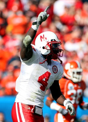JACKSONVILLE, FL - JANUARY 1:  Larry Asante #4 of the Nebraska Cornhuskers celebrates a recovered turnover during the Konica Minolta Gator Bowl against the Clemson Tigers at Jacksonville Municipal Stadium January 1, 2009 in Jacksonville, Florida.  (Photo