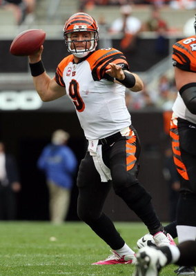 CLEVELAND - OCTOBER 04:  Carson Palmer #9 of the Cincinnati Bengals throws a pass against the Cleveland Browns during their game at Cleveland Browns Stadium on October 4, 2009 in Cleveland, Ohio. The Bengals defeated the Browns 23-20 in overtime.  (Photo