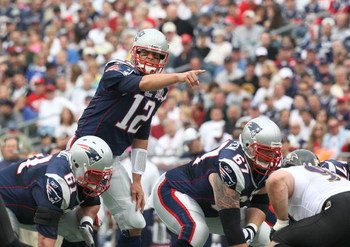 FOXBORO, MA - OCTOBER 4:  Tom Brady #12 of the New England Patriots gestures during a game against the Baltimore Ravens at Gillette Stadium on October 4, 2009 in Foxboro, Massachusetts. (Photo by Jim Rogash/Getty Images)