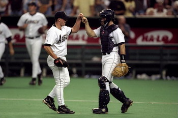 12 Sep 1998: The pitcher of the Houston Astros high-fives his catcher after the defeat of the St.Louis  Cardinals at the Astrodome in Houston, Texas. The Astos defeated the Cardinals 3-2Mandatory Credit: Andy Lyons  /Allsport