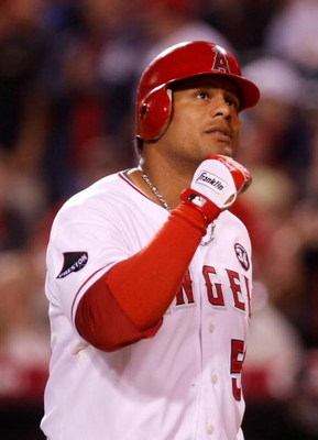 ANAHEIM, CA - SEPTEMBER 29:  Bobby Abreu #53 of the Los Angeles Angels of Anaheim pumps his fist after hitting a solo home run in the first inning against the Texas Rangers at Angel Stadium on September 29, 2009 in Anaheim, California. The Angels defeated