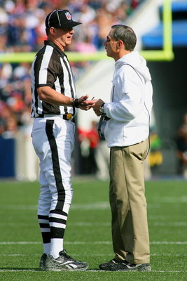 ORCHARD PARK, NY - SEPTEMBER 20:  Head Coach Dick Jauron of the Buffalo Bills talks with an official during a break from the game against the Tampa Bay Buccaneers at Ralph Wilson Stadium on September 20, 2009 in Orchard Park, New York.  The Bills won 33-2