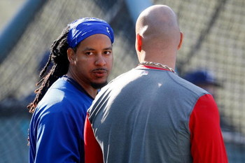 LOS ANGELES, CA - OCTOBER 07:  Manny Ramirez #99 of the Los Angeles Dodgers talks with Albert Pujols #5 of the St. Louis Cardinals before Game One of the NLDS during the 2009 MLB Playoffs at Dodger Stadium on October 7, 2009 in Los Angeles, California.  (