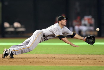 PHOENIX - JULY 26:  Infielder Andy LaRoche #15 of the Pittsburgh Pirates dives while attempting to field a single hit by the Arizona Diamondbacks during the major league baseball game at Chase Field on July 26, 2009 in Phoenix, Arizona. The Diamondbacks d