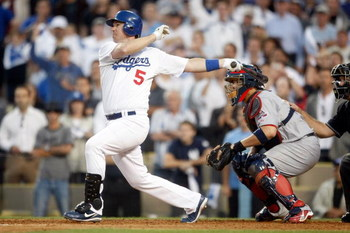 LOS ANGELES, CA - OCTOBER 08:  Mark Loretta #5 of the Los Angeles Dodgers hits a walk-off RBI single to center to score Casey Blake #23 to defeat the St. Louis Cardinals in Game Two of the NLDS during the 2009 MLB Playoffs at Dodger Stadium on October 8,