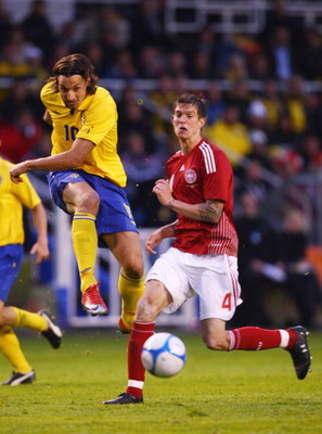 SOLNA, SWEDEN - JUNE 06:  Zlatan ibrahimovic (L) of Sweden shoots past Daniel Agger (R) of Denmark during the FIFA2010 World Cup Qualifying Group 1 match between Sweden and Denmark at the Rasunda Stadium on June 6, 2009 in Solna, Sweden.  (Photo by Michae