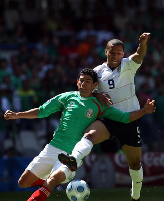 MEXICO CITY - AUGUST 12:  Jonny Magallon #2 of Mexico and Charlie Davies #9 of the USA clash for the ball during the FIFA World Cup Qualifying soccer match between the USA and Mexico at Azteco Stadium August 12, 2009 in Mexico City, Mexico.  (Donald Miral