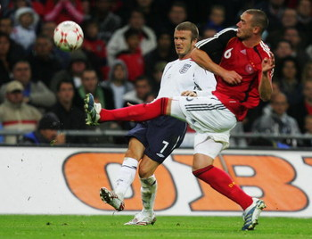 LONDON - AUGUST 22: Christian Pander of Germany takes the ball from David Beckham of England during the international friendly match between England and Germany at Wembley stadium on August 22, 2007 in London, England.  (Photo by Martin Rose/Bongarts/Gett