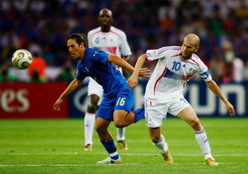 BERLIN - JULY 09:  Mauro Camoranesi of Italy (L) holds off Zinedine Zidane of France during the FIFA World Cup Germany 2006 Final match between Italy and France at the Olympic Stadium on July 9, 2006 in Berlin, Germany.  (Photo by Shaun Botterill/Getty Im