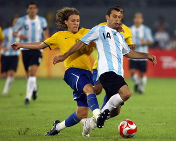 BEIJING - AUGUST 19:  Javier Mascherano of Argentina is tackled by Lucas of Brazil during the men's football semifinal match at Workers' Stadium on Day 11 of the Beijing 2008 Olympic Games on August 19, 2008 in Beijing, China.  (Photo by Shaun Botterill/G