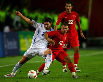 ISTANBUL, TURKEY - OCTOBER 17: Ioannis Amanatidis of Greece (l) battles with Turkey forward Gokdeniz Karadeniz during the Euro 2008 Qualifying match between Turkey and Greece at Ali Sami Yen Stadium on October 17, 2007 in Istanbul,Turkey.  (Photo by Stu F