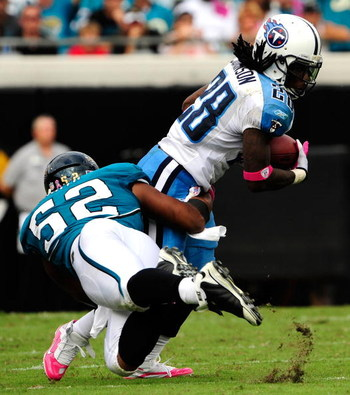 JACKSONVILLE, FL - OCTOBER 04:  Chris Johnson #28 of the Tennessee Titans is tackled by Daryl Smith # 52 of the Jacksonville Jaguars during the game at Jacksonville Municipal Stadium on October 4, 2009 in Jacksonville, Florida.  (Photo by Sam Greenwood/Ge