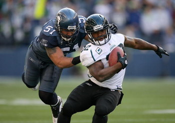 SEATTLE - OCTOBER 11:  Running back Maurice Jones-Drew #32 of the Jacksonville Jaguars is tackled by Lofa Tatupu #51 of the Seattle Seahawks on October 11, 2009 at Qwest Field in Seattle, Washington. The Seahawks defeated the Jaguars 41-0. (Photo by Otto