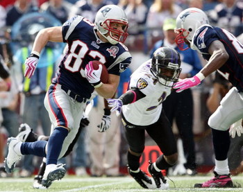 FOXBORO, MA - OCTOBER 04:  Wes Welker #83 of the New England Patriots carries the ball around Domonique Foxworth #24 of the Baltimore Ravens on October 4, 2009 at Gillette Stadium in Foxboro, Massachusetts.  (Photo by Elsa/Getty Images)