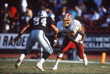 29 OCT 1989:  WASHINGTON REDSKINS DEFENSIVE END DEXTER MANLEY PUTS A RUSH ON LOS ANGELES RAIDERS TIGHT END MIKE DYAL DURING THE RAIDERS'' 37-24 WIN AT THE LOS ANGELES COLISEUM IN LOS ANGELES, CALIFORNIA.   Mandatory Credit: Mike Powell/ALLSPORT