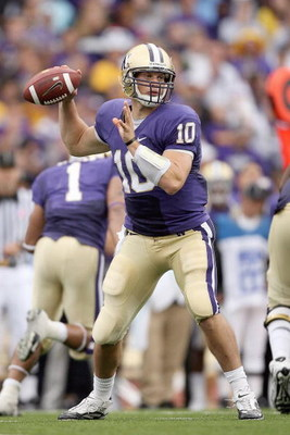 SEATTLE - SEPTEMBER 19: Quarterback Jake Locker #10 of the Washington Huskies looks to pass the ball during the game against the USC Trojans on September 19, 2009 at Husky Stadium in Seattle, Washington. The Huskies defeated the Trojans 16-13. (Photo by O