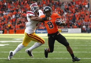 CORVALIS, OR - SEPTEMBER 25:   James Rodgers #8 of the Oregon State Beavers runs for a touchdown against Taylor Mays #2 of the Southern California Trojans at Reser Stadium on September 25, 2008 in Corvalis, Oregon.  (Photo by Jonathan Ferrey/Getty Images)
