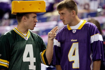 MINNEAPOLIS - OCTOBER 05:  Fans of Brett Favre #4  of the Minnesota Vikings talk prior to the start of the game against of the Green Bay Packers on October 5, 2009 at Hubert H. Humphrey Metrodome in Minneapolis, Minnesota.  (Photo by Jamie Squire/Getty Im