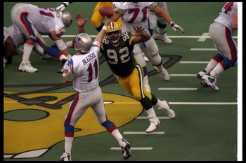 26 Jan 1997:  Defensive lineman Reggie White of the Green Bay Packers closes in on New England Patriots quarterback Drew Bledsoe during Super Bowl XXXI at the Superdome in New Orleans, Louisiana.  The Packers won the game, 35-21. Mandatory Credit: Stephen