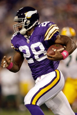 MINNEAPOLIS - OCTOBER 05:  Running back Adrian Peterson #28 of the Minnesota Vikings carries the ball during the game against the Green Bay Packers on October 5, 2009 at Hubert H. Humphrey Metrodome in Minneapolis, Minnesota.  (Photo by Jamie Squire/Getty
