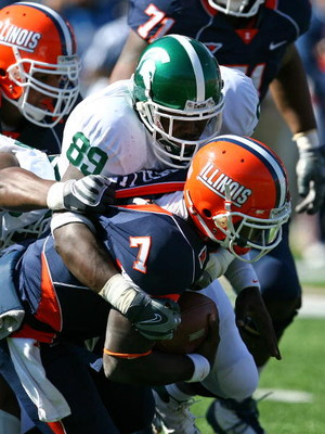 CHAMPAIGN, IL - OCTOBER 10: Juice Williams #7 of the Illinois Fighting Illini is sacked by Colin Neely #89 of the Michigan State Spartans on October 10, 2009 at Memorial Stadium at the University of Illinois in Champaign, Illinois. Michigan State defeated