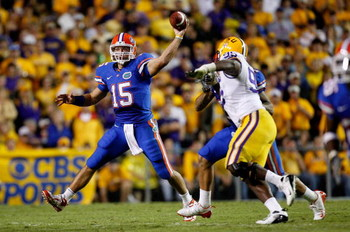 BATON ROUGE, LA - OCTOBER 10:  Quarterback Tim Tebow #15 of the Florida Gators scrambles as he throws a pass against the Louisiana State University Tigers at Tiger Stadium on October 10, 2009 in Baton Rouge, Louisiana.  (Photo by Kevin C. Cox/Getty Images