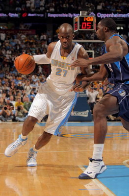 DENVER - MAY 03:  Johan Petro #27 of the Denver Nuggets drives against the defense of Brandon Bass #32 of the Dallas Mavericks in Game One of the Western Conference Semifinals during the 2009 NBA Playoffs at Pepsi Center on May 3, 2009 in Denver, Colorado