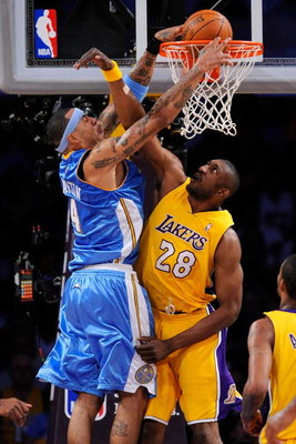 LOS ANGELES, CA - MAY 19:  Kenyon Martin #4 of the Denver Nuggets goes up for a dunk over DJ Mbenga #28 of the Los Angeles Lakers in the second quarter of Game One of the Western Conference Finals during the 2009 NBA Playoffs at Staples Center on May 19,