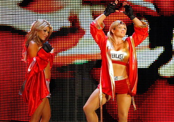 LAS VEGAS - AUGUST 24:  Wrestlers Rosa Mendes (L) and Beth Phoenix make their entrance during the WWE Monday Night Raw show at the Thomas & Mack Center August 24, 2009 in Las Vegas, Nevada.  (Photo by Ethan Miller/Getty Images)