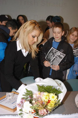 GARDEN CITY, NY - MARCH 3:  World Wrestling Entertainment (WWE) professional wrestler Trish Stratus (L) signs autographs during the 'Professor For A Day' event at Nassau Community College March 3, 2003 in Garden City, New York. Stratus acted as an assista