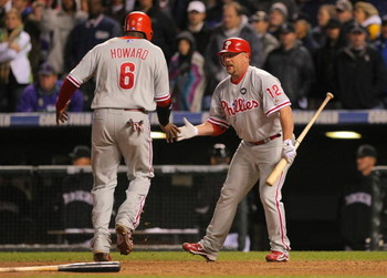 DENVER - OCTOBER 12:  Matt Stairs #12 of the Philadelphia Phillies congratulates teammate Ryan Howard #6 after Howard scored the go ahead run against the Colorado Rockies in the top of the ninth inning giving the Phillies a 5-4 lead in Game Four of the NL