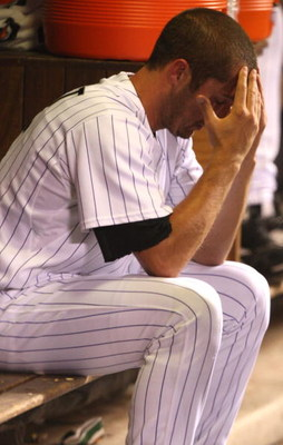 DENVER - OCTOBER 12: Huston Street #16 of the Colorado Rockies sits dejected in the dugout against the Philadelphia Phillies in Game Four of the NLDS during the 2009 MLB Playoffs at Coors Field on October 12, 2009 in Denver, Colorado. (Photo by Jed Jacobs