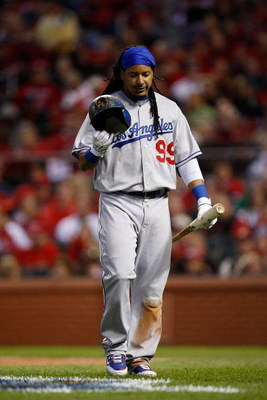ST. LOUIS , MO - OCTOBER 10:  :  :  :  :  Manny Ramirez #99 of the Los Angeles Dodgers in Game Three of the NLDS during the 2009 MLB Playoffs at Busch Stadium on October 10, 2009 in St. Louis, Missouri.  (Photo by Ronald Martinez/Getty Images)