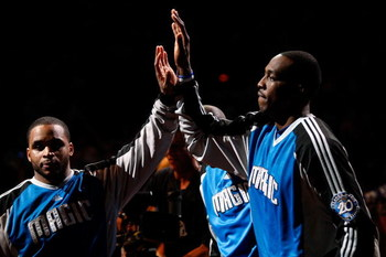 ORLANDO, FL - JUNE 11:  Dwight Howard #12 high fives teammate Jameer Nelson #14 of the Orlando Magic before Game Four of the 2009 NBA Finals against the Los Angeles Lakers on June 11, 2009 at Amway Arena in Orlando, Florida.  NOTE TO USER:  User expressly