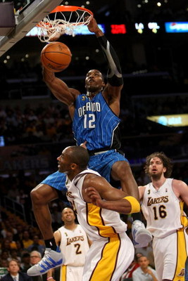 LOS ANGELES, CA - JUNE 07:  Dwight Howard #12 of the Orlando Magic slam dunks over Kobe Bryant #24 of the Los Angeles Lakers in Game Two of the 2009 NBA Finals at Staples Center on June 7, 2009 in Los Angeles, California. NOTE TO USER: User expressly ackn