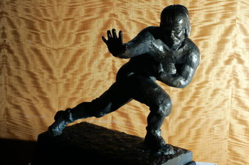 NEW YORK - DECEMBER 5:  The original cast of the 1935 Heisman trophy is displayed December 5, 2005 in New York City. The plaster cast sculpture for what became the Heisman trophy is estimated to sell for $200,000 to $300,000 at auction December 10.  (Phot