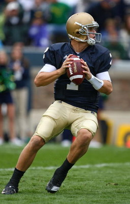 SOUTH BEND, IN - OCTOBER 03: Jimmy Clausen #7 of the Notre Dame Fighting Irish looks for a receiver against the Washington Huskies on October 3, 2009 at Notre Dame Stadium in South Bend, Indiana. Notre Dame defeated Washington 37-30 in overtime. (Photo by