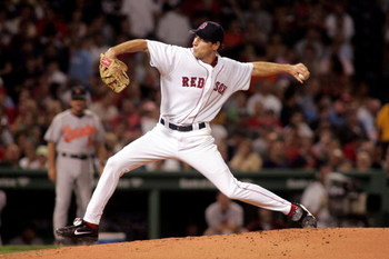 BOSTON - SEPTEMBER 2:  Starting pitcher Lenny DiNardo #55 of the Boston Red Sox pitches in the second inning against the Baltimore Orioles at Fenway Park on September 2, 2005 in Boston, Massachusetts.  (Photo by Jim McIsaac/Getty Images)