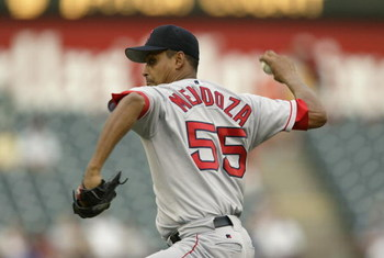 ARLINGTON, TEXAS - JULY 30:  Pitcher Ramiro Mendoza #55 of the Boston Red Sox delivers a pitch during the American League game against the Texas Rangers at the Ballpark in Arlington on July 30, 2003 in Arlington, Texas.  The Rangers defeated the Red Sox 9