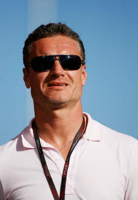 BUDAPEST, HUNGARY - JULY 24:  Former F1 driver David Coulthard of Great Britain walks down the paddock following practice for the Hungarian Formula One Grand Prix at the Hungaroring on July 24, 2009 in Budapest, Hungary.  (Photo by Paul Gilham/Getty Image