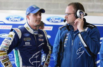 BATHURST, AUSTRALIA - OCTOBER 10:  Tim Edwards team principal for Ford Performance Racing talks with driver Mark Winterbottom after his qualifying lap during qualifying for the Bathurst 1000, which is round 10 of the V8 Supercars Championship Series at Mo