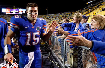 BATON ROUGE, LA - OCTOBER 10:  Quarterback Tim Tebow #15 of the Florida Gators celebrates their 13-3 win over the Louisiana State University Tigers with fans at Tiger Stadium on October 10, 2009 in Baton Rouge, Louisiana.  (Photo by Kevin C. Cox/Getty Ima