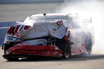 FONTANA, CA - OCTOBER 11:  Kasey Kahne, driver of the #9 Budweiser Dodge, drives down pit road after a multi-car incident during the NASCAR Sprint Cup Series Pepsi 500 at Auto Club Speedway on October 11, 2009 in Fontana, California.  (Photo by Rusty Jarr