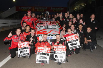 BATHURST, AUSTRALIA - OCTOBER 11:  The Holden Racing Team pose for a team photo after drivers Will Davison and Garth Tander drivers of the #2 Holden Racing Team Holden won the Bathurst 1000, which is round 10 of the V8 Supercars Championship Series  at Mo