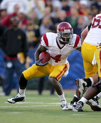 BERKELEY, CA - OCTOBER 03:  Joe McKnight #4 of the USC Trojans runs with the ball during their game against the California Golden Bears at California Memorial Stadium on October 3, 2009 in Berkeley, California.  (Photo by Ezra Shaw/Getty Images)