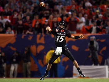 MIAMI - JANUARY 01:  Tony Pike #15 of the Cincinnati Bearcats passes against the Virginia Tech Hokies during the FedEx Orange Bowl at Dolphin Stadium on January 1, 2009 in Miami, Florida.  (Photo by Marc Serota/Getty Images)
