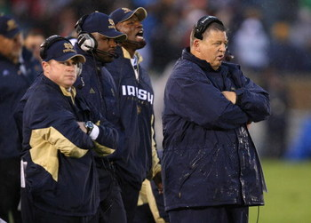 SOUTH BEND, IN - OCTOBER 03: Head coach Charlie Weis of the Notre Dame Fighting Irish and his staff watch as their team takes on the Washington Huskies on October 3, 2009 at Notre Dame Stadium in South Bend, Indiana. Notre Dame defeated Washington 37-30 i