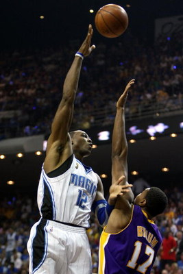 ORLANDO, FL - JUNE 14:  Dwight Howard #12 of the Orlando Magic puts a shot up over Andrew Bynum #17 of the Los Angeles Lakers in Game Five of the 2009 NBA Finals on June 14, 2009 at Amway Arena in Orlando, Florida.  NOTE TO USER:  User expressly acknowled